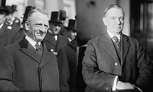 Sen. Carter Glass (D—Va.) and Rep. Henry B. Steagall (D—Ala.-3), the co-sponsors of the Glass–Steagall Act. public photo